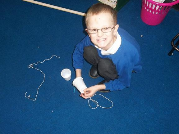 Year Four making string telephones