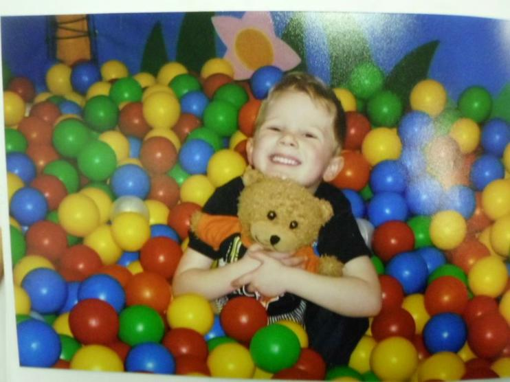 Playing in the ball pool.
