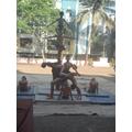 Boys balance routine on this pole- Mallakhamba.