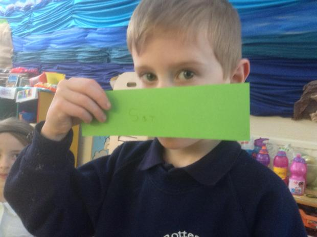 Making his own Read, write Inc words