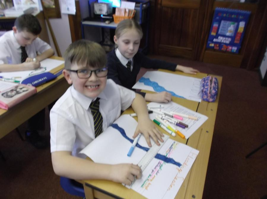 Smiling and working hard on our Egyptian posters!