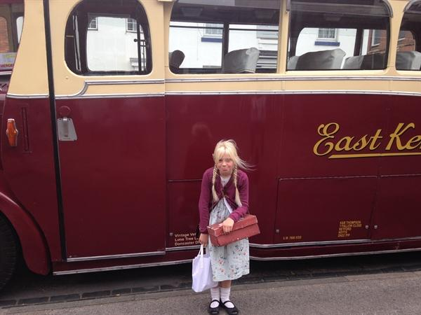 With the vintage bus