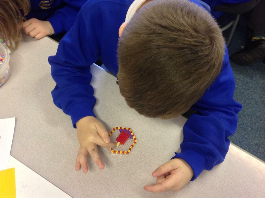 We are making Hama Bead decorations.