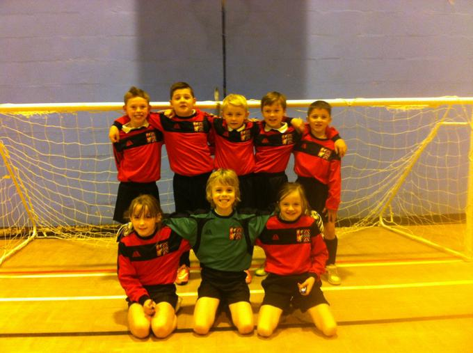 A picture of our Year 3/4 team in our very smart new kits.