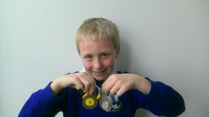 Aiden (3BE) - Oakwood Ospreys football medals!