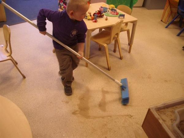 Keeping nursery clean and tidy. What a good helper
