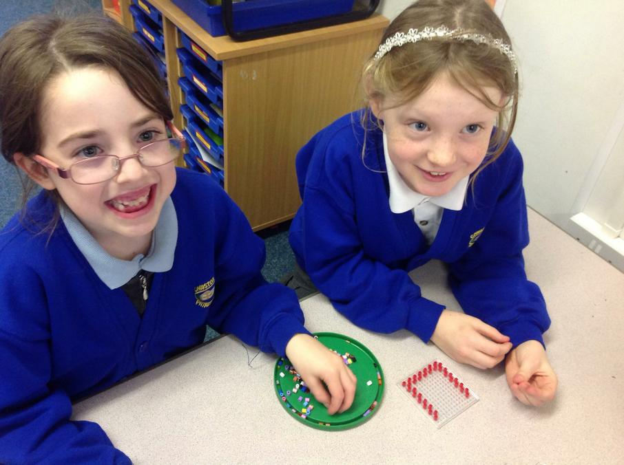 We are creating Hama bead decorations.