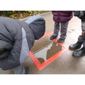 Looking at our reflection in the puddle.