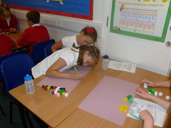 Maisie and Sammy doing numeracy