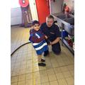 lifting a heavy long hose
