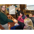 Handling a corn snake at the zoo