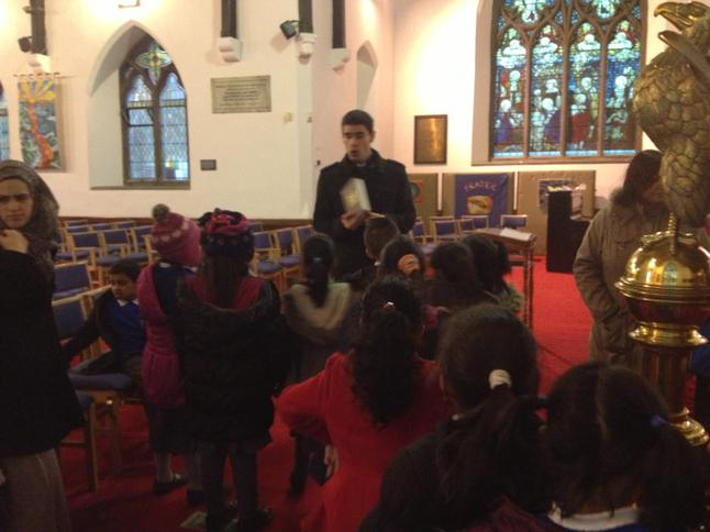 The children listening to the vicar.