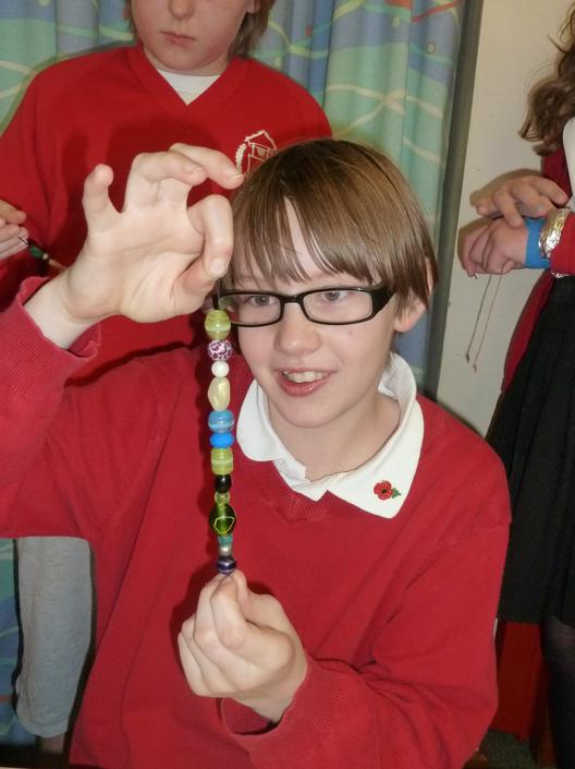We used beads of silver, amber, glass and wood...