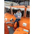 Olivia enjoys reading on the lifeboat!