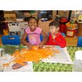 Having fun peeling a large carrot