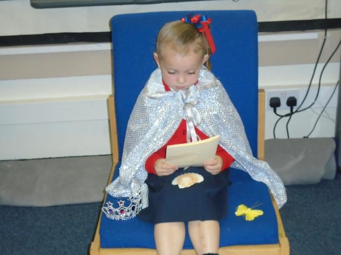 Daisy enjoyed reading her story with her cape