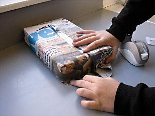 1. A box (of any size) is wrapped in newspaper.