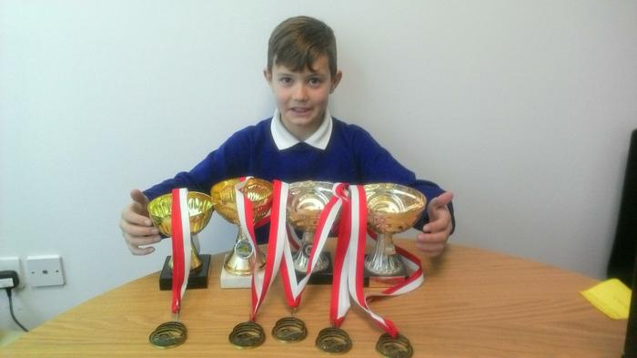 Ethan (4MG) - LOTS of swimming trophies!