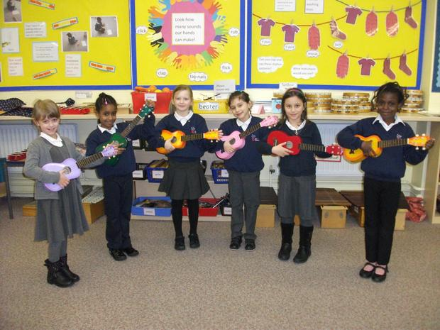 Music club learn how to play the ukelele
