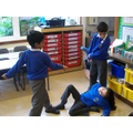 Acting out the story of Perseus.