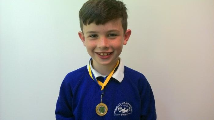 Louis shows his Pace football medal