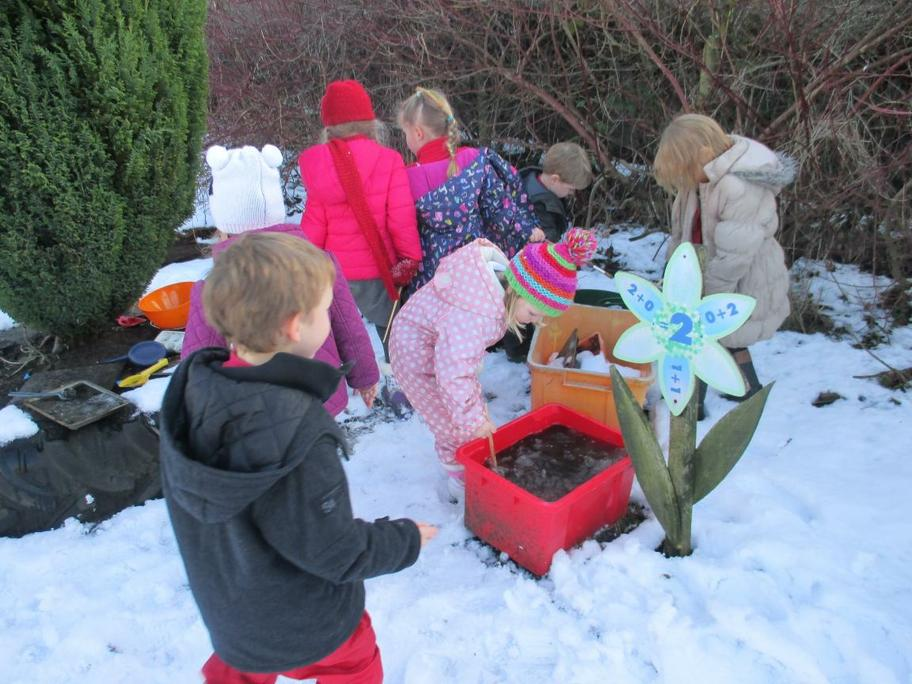 The children were very busy in the mud kitchen