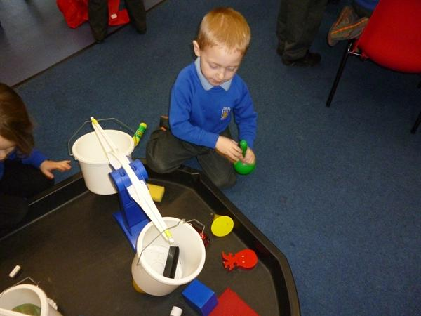 Weighing objects - which is heavy, which is light?