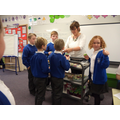 Mrs Winder delivering cakes on her trolley!