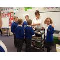 Mrs Winder delivering cakes on her trolley!
