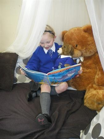 Halle read Aloysius Bear a story