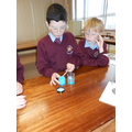 Diluting the copper sulphate.