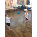 We practised throwing and catching a large ball