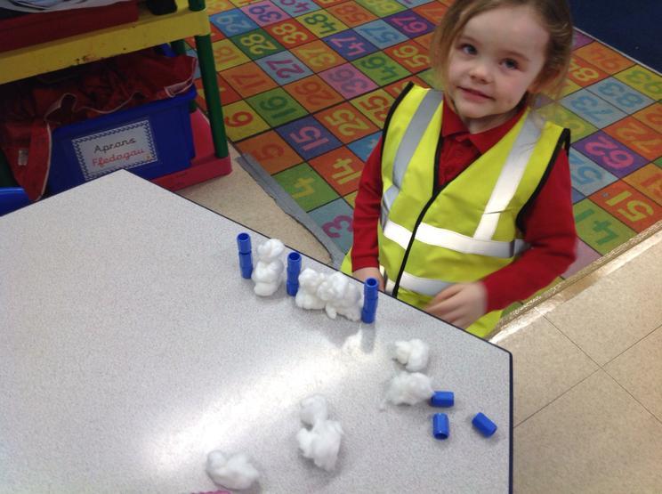 Making snowmen and measuring them.
