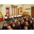 Eco Stars lead an assembly on walking to school.