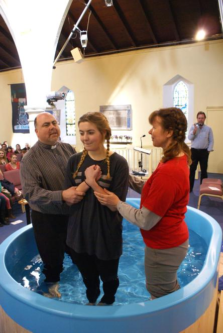 A young woman in the Baptistry just before Baptising