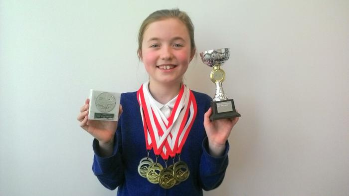 Ella (5JK) Swim awards GOLD SILVER + BRONZE!