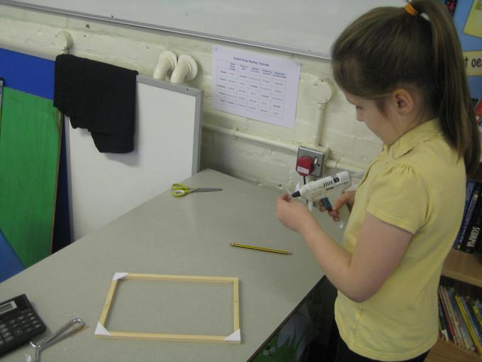 Making the frames for our art work.