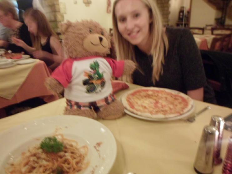 Jofli enjoying sharing his pizza. Yum yum!