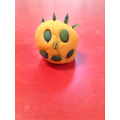 Making models out of pumpkin themed dough.