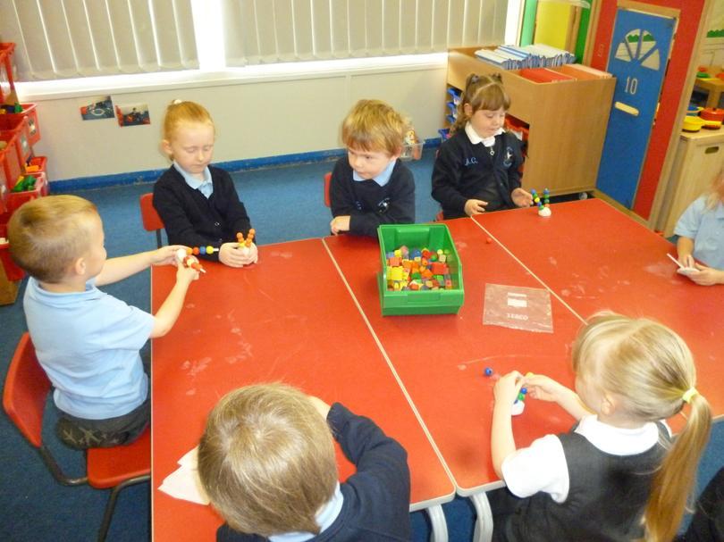 Threading beads onto straws