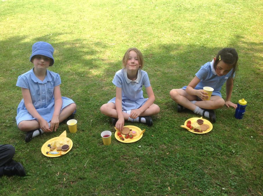 Enjoying the party food in the sunshine!
