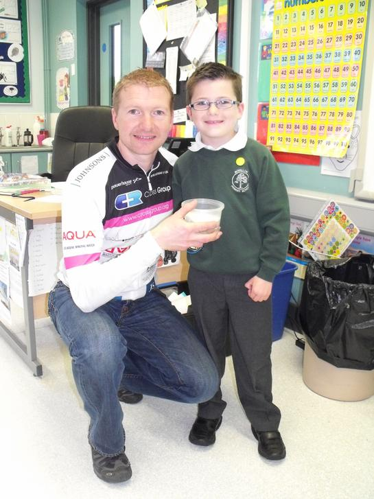 Mr Neill receiving the Primary 3 donation