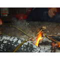 Using the embers to cook the meat