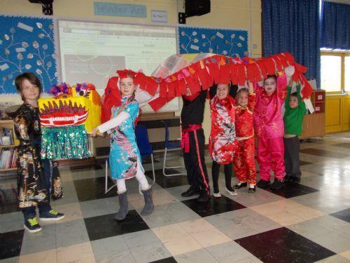 All Three year groups making th Chinese Dragon