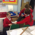 We estimated the length of items and selected the correct unit of measurement and measuring tool. We then checked our estimates by measuring the items.