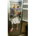 Bethany reading in the fridge