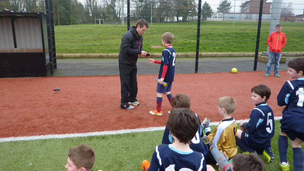 Team captain receives his medal from Mr Guy