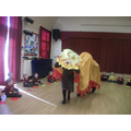Doing a dragon dance.