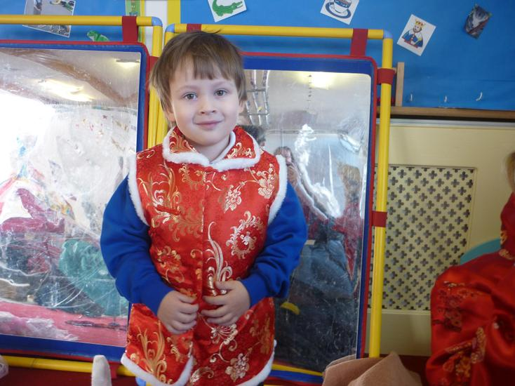 Trying on Chinese clothes.