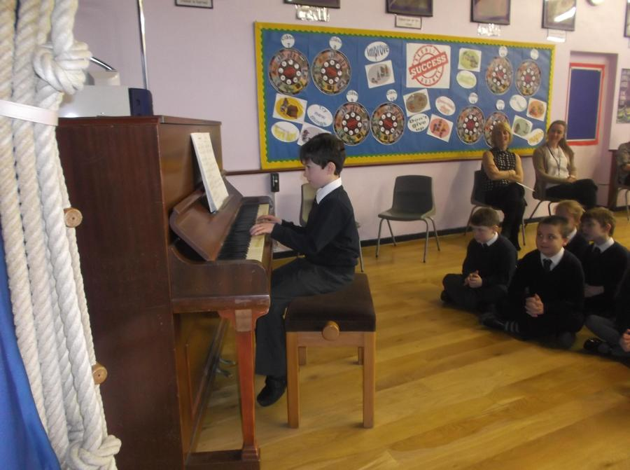 Fergal playing to the school in Assembly